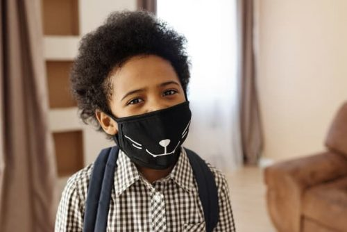 child wearing a face mask to school